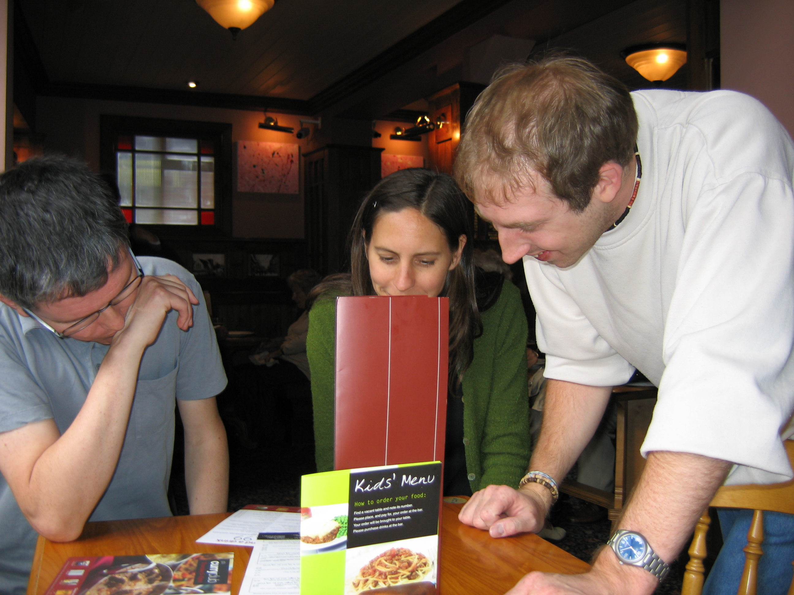 Bonnie hides behind the menu to avoid Jose's ranting about clearing